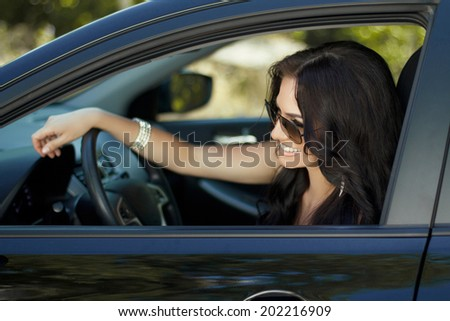 Smiling woman sitting in car, Happy girl driving automobile, outdoors summer portrait - stock photo