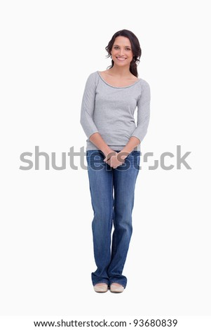 Smiling woman standing against a white background - stock photo