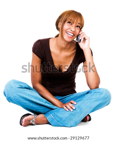 Smiling woman talking on a mobile phone isolated over white