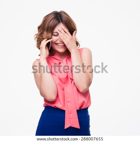 Smiling woman talking on the phone isolated on a white background - stock photo