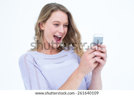 Smiling woman using smartphone on white background - stock photo