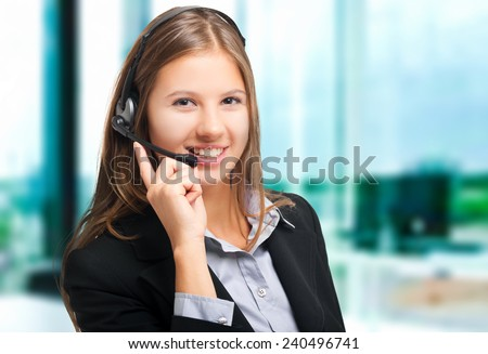 Smiling woman wearing an headset