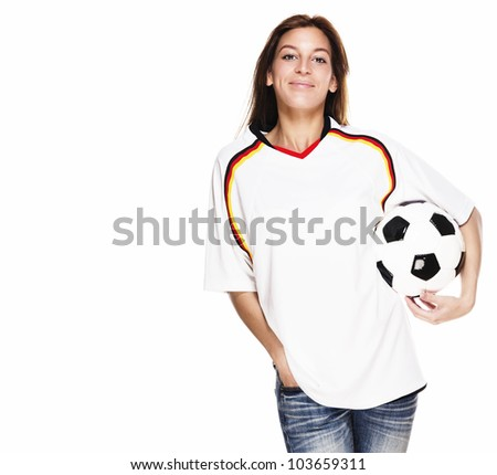smiling woman wearing football shirt with football under her arm on white background - stock photo