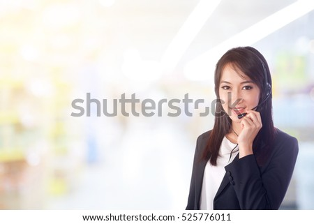Smiling woman wearing microphone headset as an operator, telemarketer, call center ,hot line and customer service staff.Positive emotion