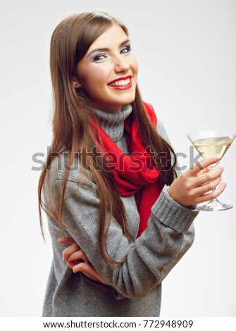 Smiling woman wearing red scarf drinking alcohol drink. Isolated portrait.