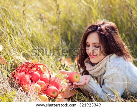 Smiling woman with a basket  - stock photo