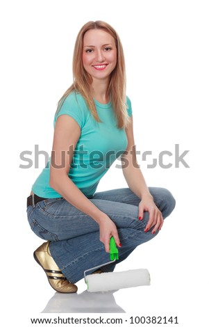Smiling woman with a brush against the white background. - stock photo