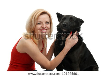 smiling woman with a dog on a white background - stock photo