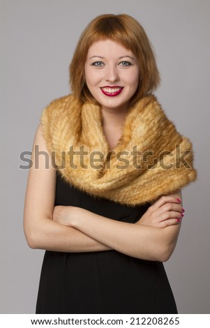 Smiling woman with a fur scarf  - stock photo