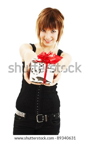 Smiling woman with a gift box. Isolated on white - stock photo