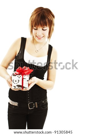 Smiling woman with a gift box. Isolated on white background - stock photo