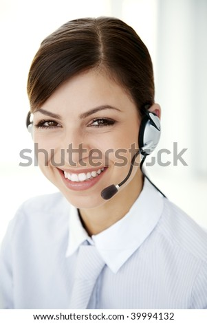 smiling woman with a headset looking at camera - stock photo