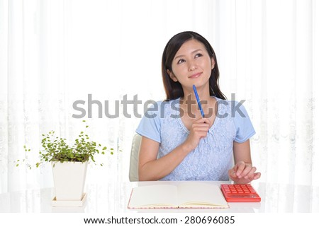 Smiling woman with a notebook