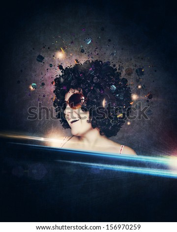 smiling woman with afro hair listen to music with headphones  over dark blue background - stock photo
