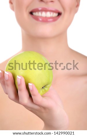 Smiling woman with apple close up
