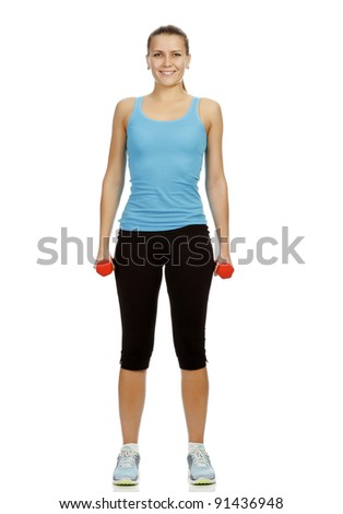 Smiling woman with barbells standing on a white floor