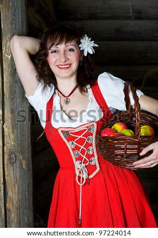Smiling woman with basket and apples