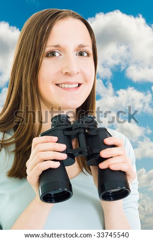 Smiling woman with binoculars looking for future