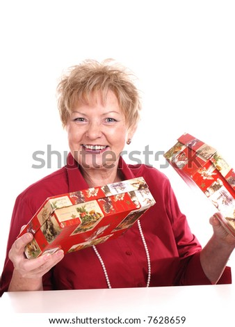 Smiling woman with christmas presents.