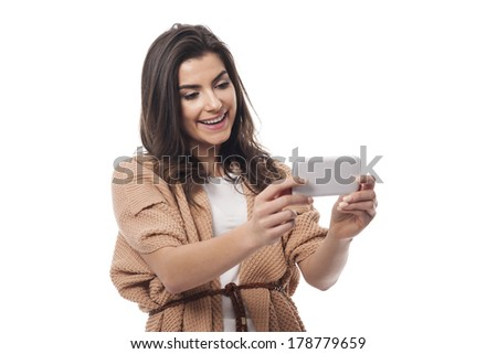 Smiling woman with contemporary mobile phone  - stock photo