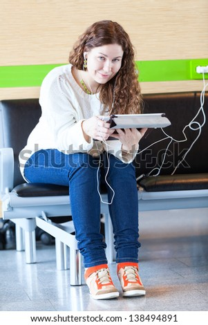 Smiling woman with electronic devices spending time - stock photo