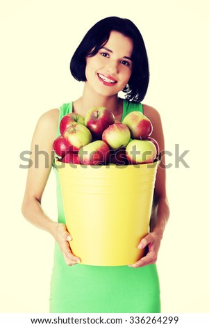 Smiling woman with fresh apples - stock photo