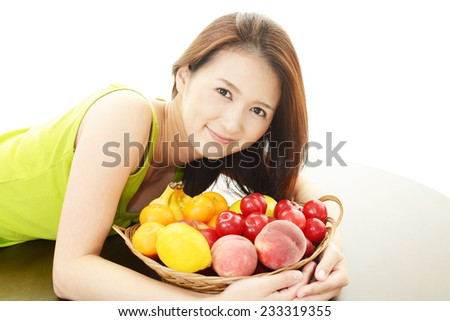 Smiling woman with fruits