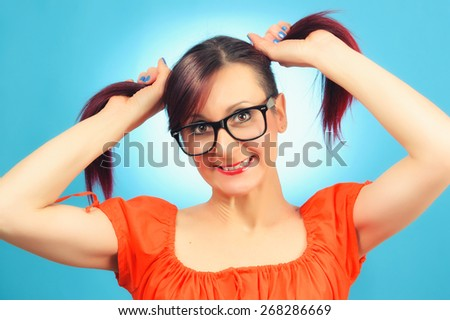Smiling woman with glasses and pigtails - stock photo