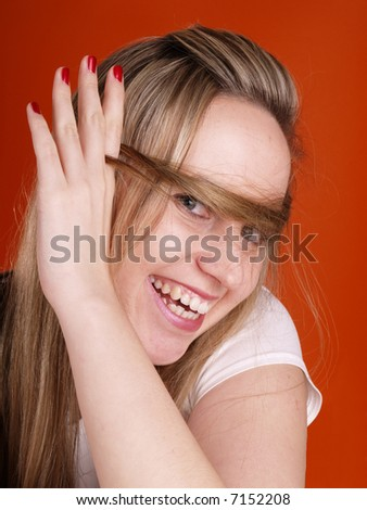 smiling woman with hair over her face
