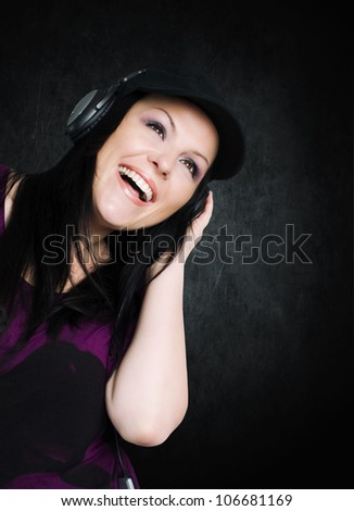 smiling woman with headphones listening music  over dark background - stock photo