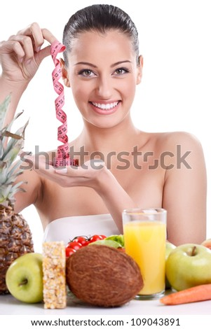 Smiling woman with healthy food and measuring tape, concept-diet - stock photo
