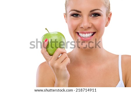 smiling woman with healthy teeth holding green apple - stock photo