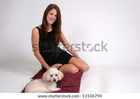 Smiling woman with her pet poodle
