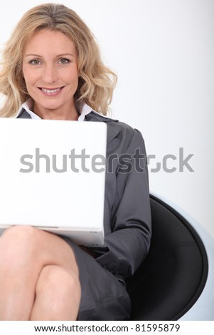 Smiling woman with laptop - stock photo