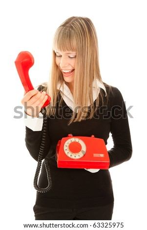 Smiling woman with old telephone - stock photo