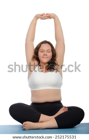 smiling woman with overweight involved in fitness on blue mat - stock photo