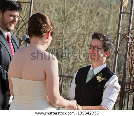 Smiling woman with partner in civil union ceremony