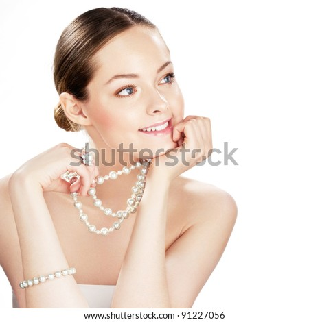 Smiling woman with pearl jewelry on white. Space for text. - stock photo