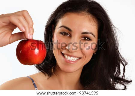 Smiling woman with red apple on white background