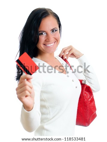 Smiling woman with red credit card and bag. Isolated on white. - stock photo