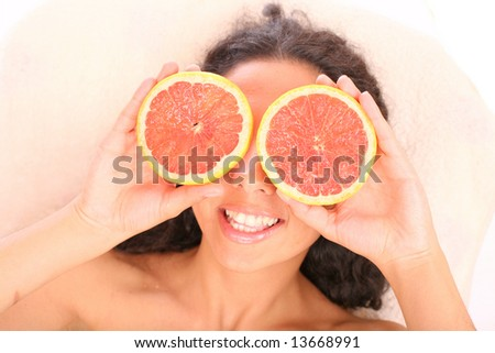 smiling woman with rings of a grapefruit
