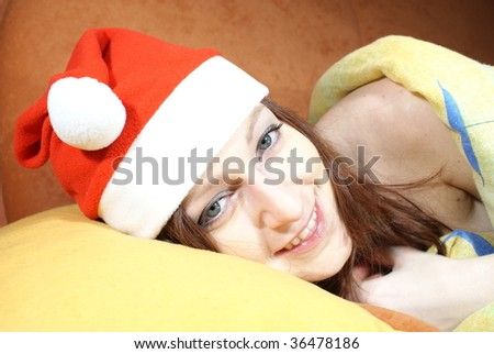 Smiling woman with santa cap