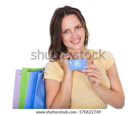 Smiling Woman With Shopping Bags Holding Credit Card Over White Background