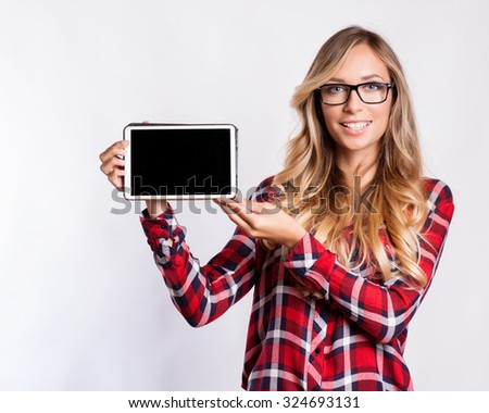 Smiling woman with tablet computer - stock photo