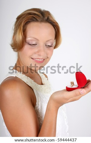 smiling woman with wedding rings - stock photo