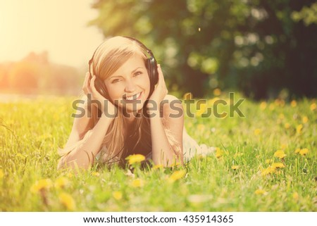 Smiling woman Woman listening to music on headphones outdoors