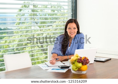 Smiling woman working home laptop business computer - stock photo