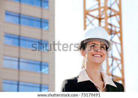 Smiling woman working on construction - stock photo