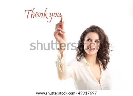 Smiling woman writing thank you - stock photo