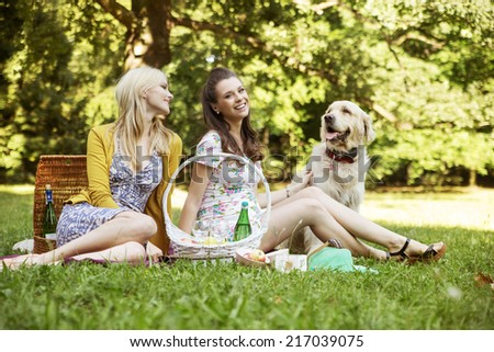 Smiling women at the park - stock photo